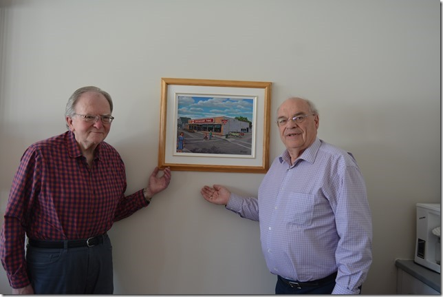 """""""Arnold Cowper (left), a well known local artist, donated to Woodstock Masonic Housing an oil painting of the former Canadian Tire Store which was located on Queen Street, Woodstock. The painting is prominently placed on the wall of the Complex Common Room for all to enjoy. March 2019"""""""